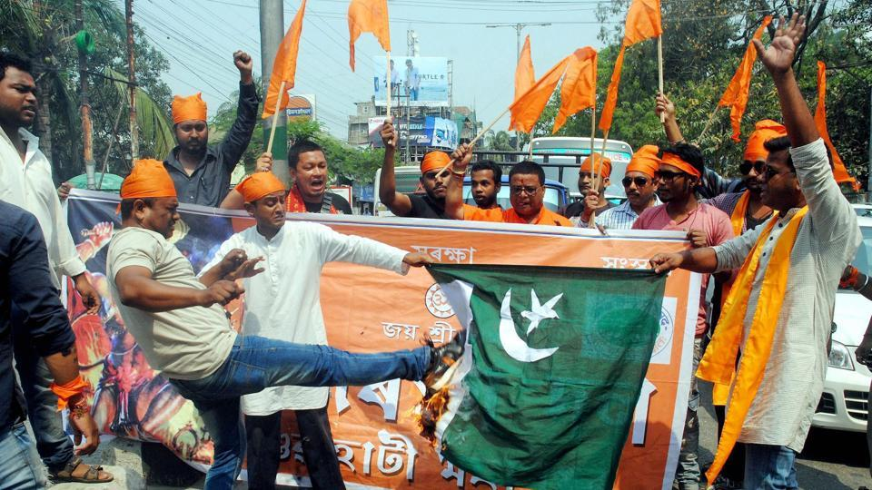 Bajrang Dal activists burn a Pakistani flag during a protest against the death sentence awarded to former Indian Naval officer Kulbhushan Jadhav by a Pakistani court.
