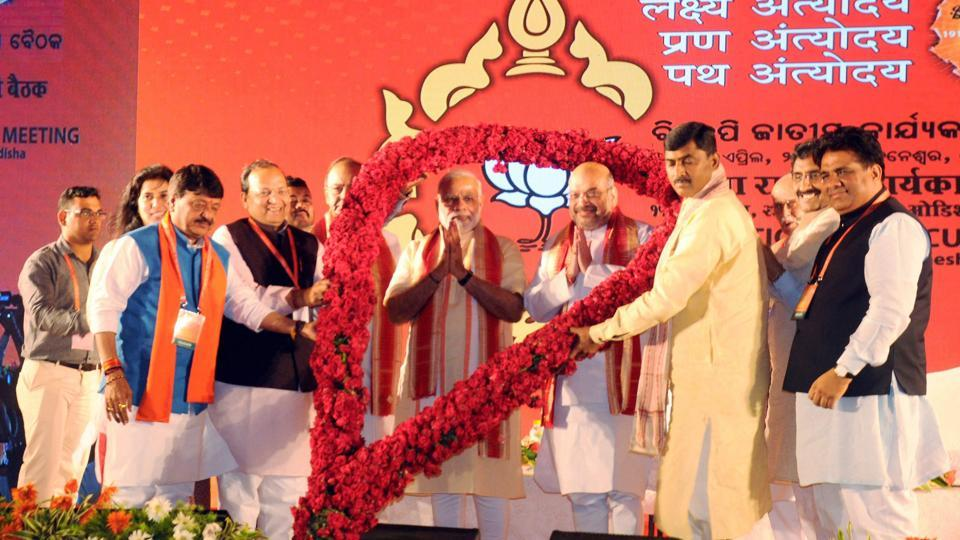 PM Narendra Modi with BJP president Amit Shah at the party's national executive meet in Bhubaneswar. Shah said at the meet that the BJP's golden era will begin only when it has CMs in every state and holds power from panchayat to Parliament.