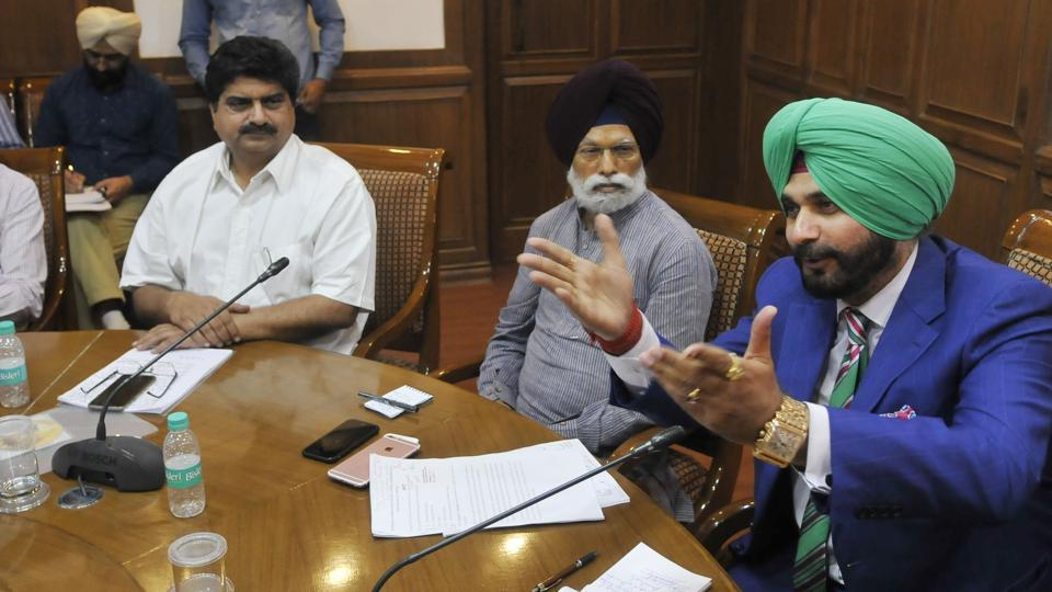 Punjab tourism and cultural affairs minister Navjot Singh Sidhu at a meeting with artists  in Chandigarh onSunday.
