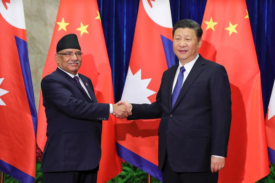 Chinese President Xi Jinping (right) shakes hands with Nepalese Prime Minister Pushpa Kamal Dahal (left) at the Great Hall of the People in Beijing in March.