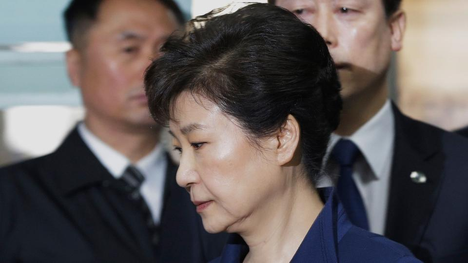 South Korea's ousted president Park Geun-Hye (front) arriving for questioning on her arrest warrant at the Seoul Central District Court in Seoul.