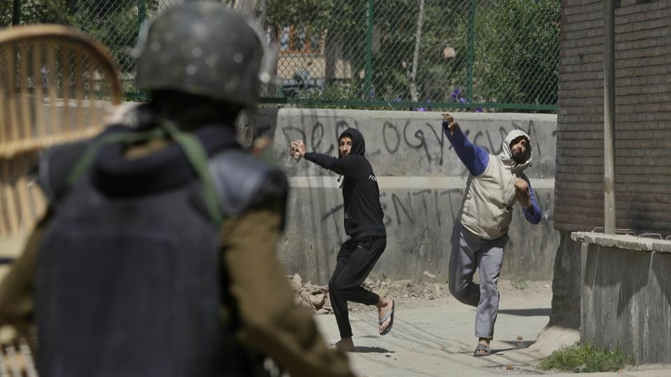 Kashmiri protesters throw stones on soldiers during a protest in Srinagar, Kashmir.