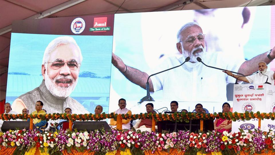 Prime Minister Narendra Modi addresses a public meeting in Bajipura, Gujarat, on Monday.