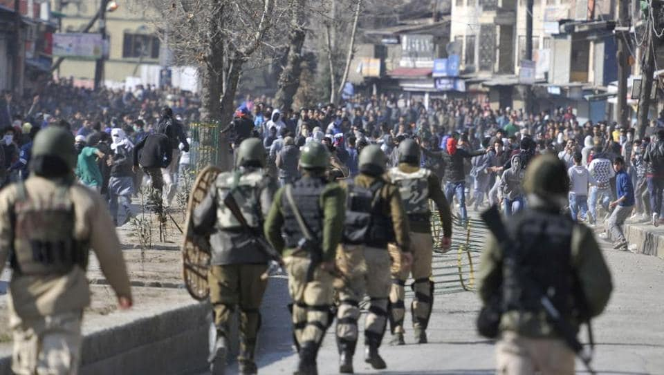 Protesters clash with police and paramilitary soldiers during a protest after Friday prayers in Srinagar.