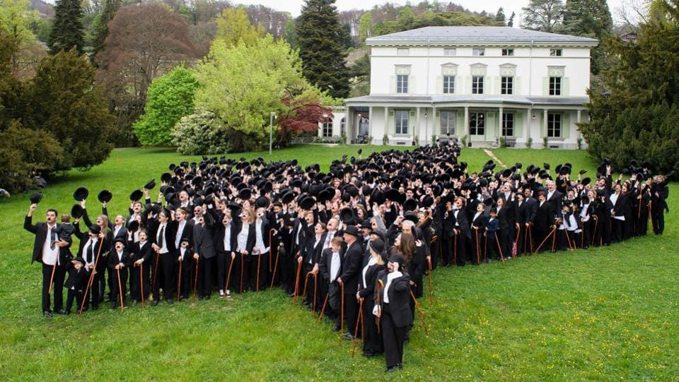 662 people dressed as Charlie Chaplin pose for a group photo in front of the Manoir de Ban. (Richard Juilliart / AFP)