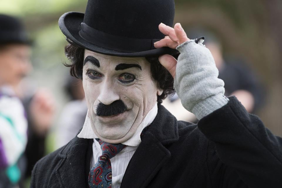 Hundreds of Charlie Chaplin fans dressed as his 'Tramp' character have gathered at the silent film star's former home in Switzerland, marking what would have been his 128th birthday. (Richard Juilliart / AFP)