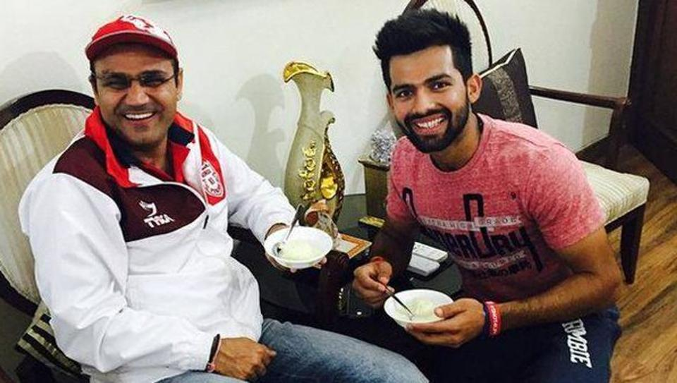 Manan Vohar (R), who scored a superb 95 during Kings XI Punjab's IPL 2017 match against Sunrisers Hyderabad, had promised Virender Sehwag (L), that he would bat for long. [File photo]