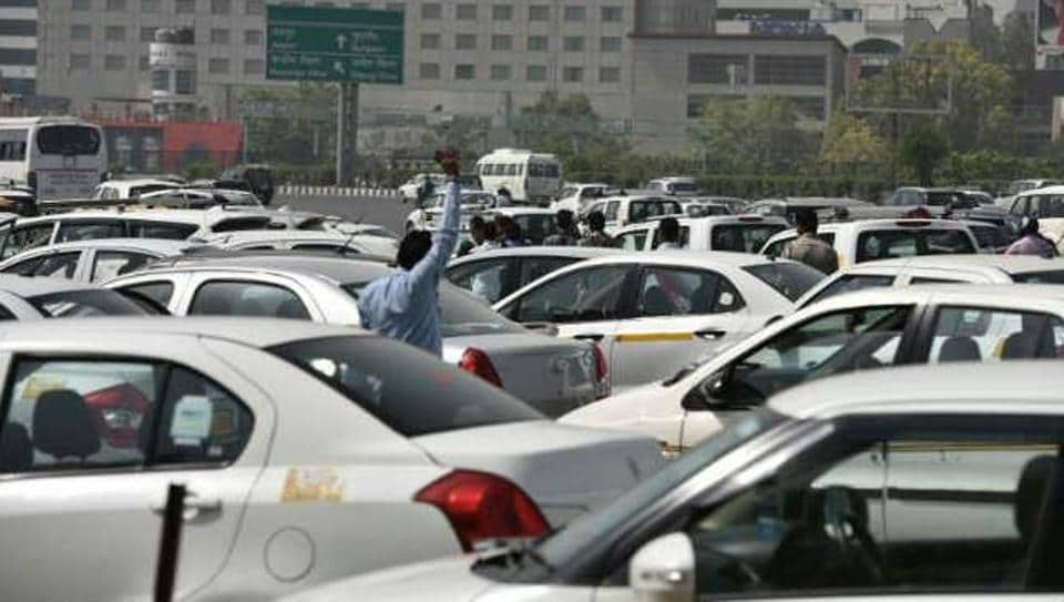 Cab drivers of app-based aggregators parked vehicles at Delhi-Gurgaon border in Sarhaul on Delhi-Gurgaon expressway as they strike work.