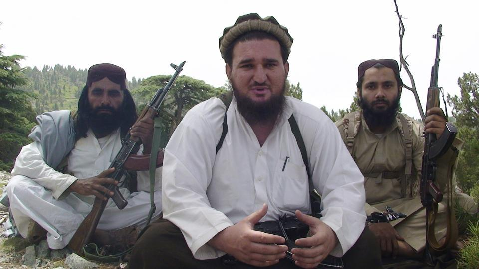In this August 6, 2012 file photo, Ahsanullah Ahsan, center, talks to The Associated Press in the militant group's stronghold of Shawal, in the Pakistani tribal region of South Waziristan. Pakistani authorities are questioning Ahsan, a senior militant who they say voluntarily surrendered, presenting it as a major setback for an Islamic extremist group that has carried out several major attacks.