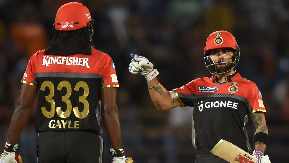 Royal Challengers Bangalore skipper Virat Kohli (right) and Chris Gayle hit half-centuries and raised a century partnership to power IPL2016 runners-up against Gujarat Lions in Rajkot on Tuesday.