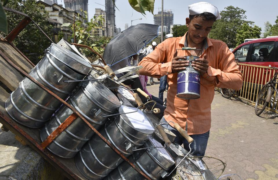 A dabbawala sorts tiffin boxes at Lower Parel on Monday.  The Rs40-45-crore industry, with 5,000 delivery men, transports 2,00,000 lunch boxes daily.