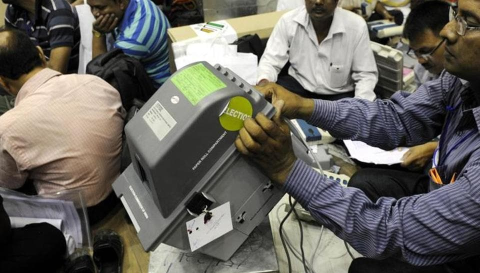 Election Commission of India introducing Voter Verifiable Paper Audit Trail (VVPAT) at a polling station.