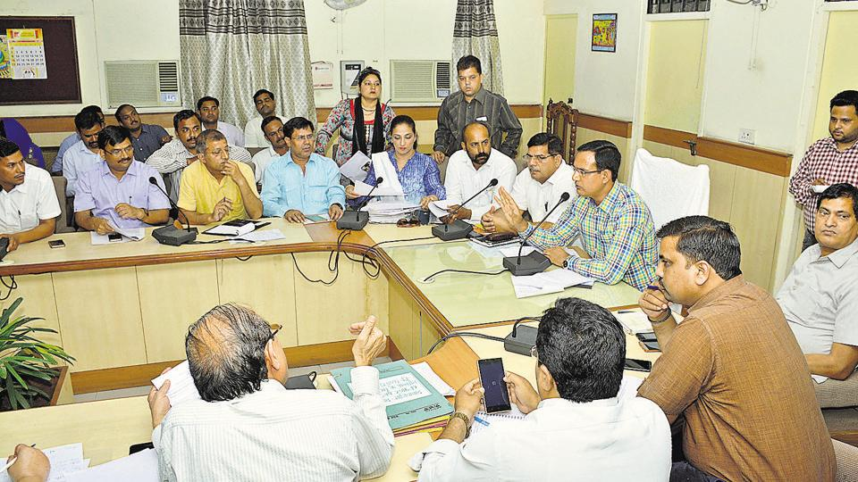 The officials held a meeting scheduled at the district headquarters for Tuesday with representatives of various parents' associations and of 15 schools against whom the parents had complained regarding fee hike.