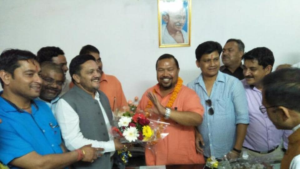 BJP leader Dan Singh Rawat is greeted by supporters after he was elected unopposed as the new chairman of the state cooperative bank in Haldwani on Tuesday.