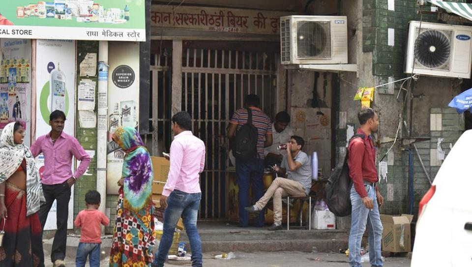 The liquor shop opposite Amrapali hospital and Yatharth hospital in Greater Noida. Some people can be seen drinking outside the shop.