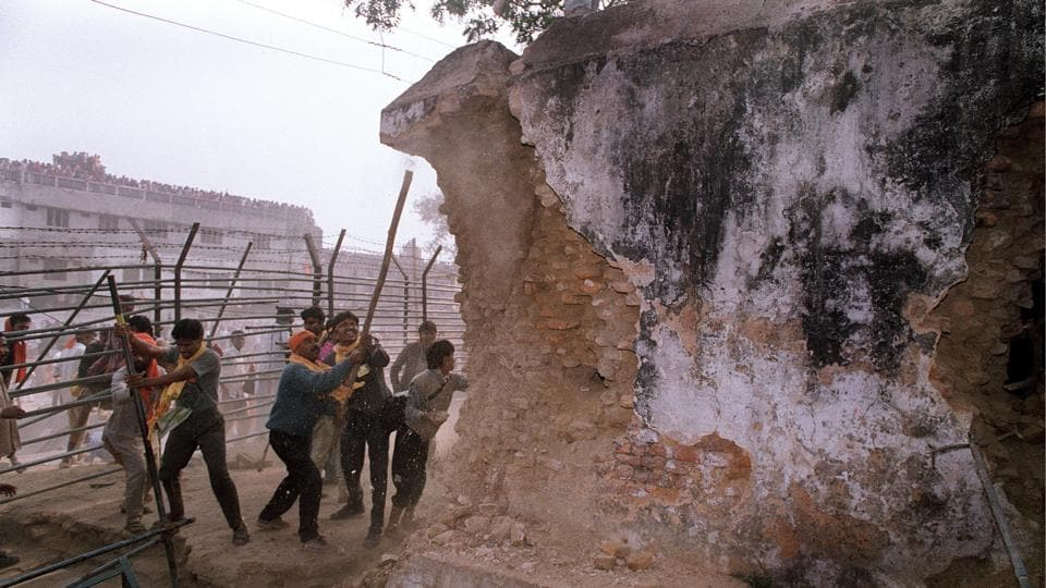 In this photograph taken on December 6, 1992, a Hindu mob attacks the wall of the 16th century Babri masjid in Ayodhya. The Supreme Court on Wednesday revived criminal conspiracy charges against BJP leaders LK Advani, Murli Manohar Joshi, Uma Bharti and nine others in the case.