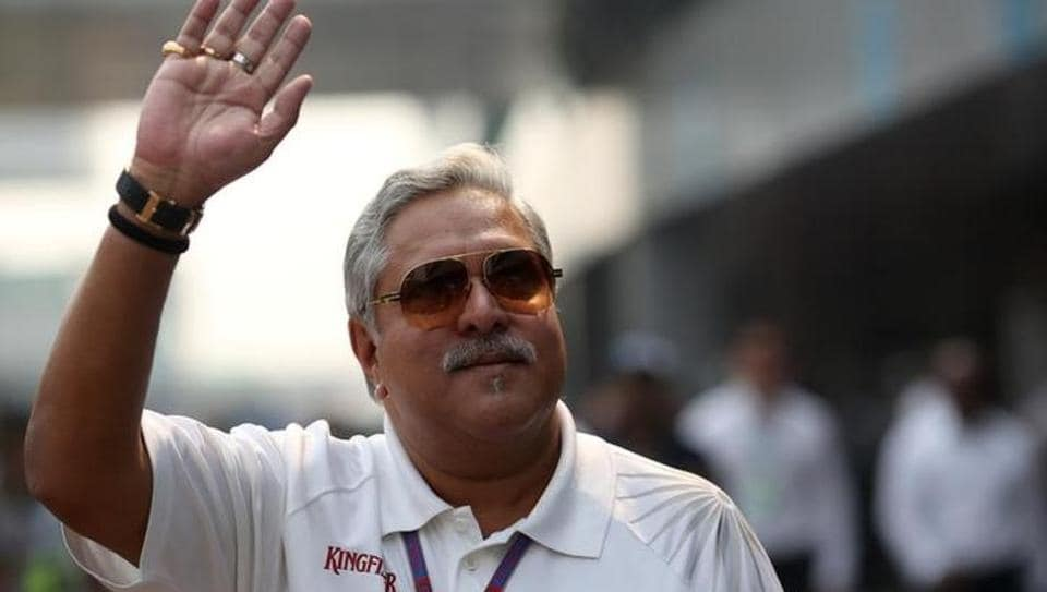Vijay Mallya waves in the paddock during the a practice session of the Indian F1 Grand Prix at the Buddh International Circuit in Greater Noida, on the outskirts of New Delhi.