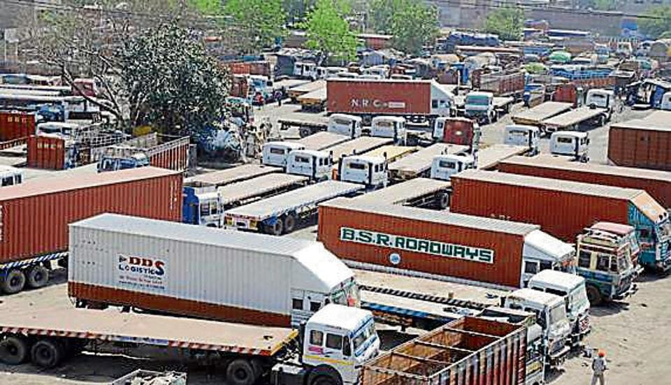 Trucks remain stationed during truck operator association's strike against GST in Ludhiana.