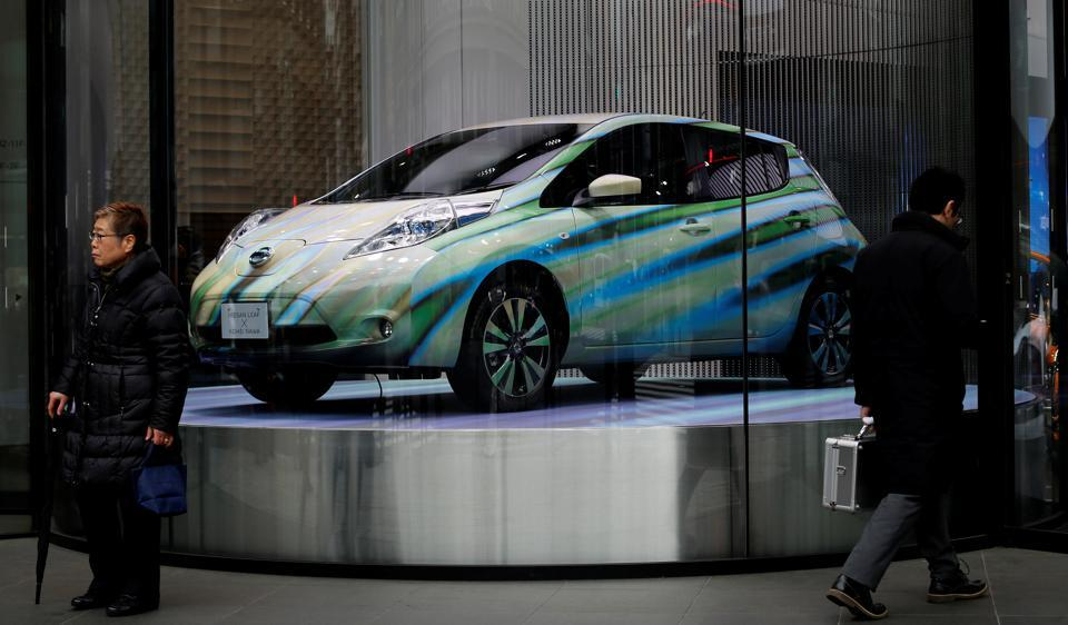 A Nissan Leaf electric car is displayed at its showroom in Tokyo, Japan. The Leaf may come to India soon this year, Nissan hinted.
