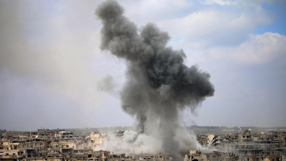 Jets struck the town of al-Bukamal killing three militants and 13 civilians including children, the monitor said.