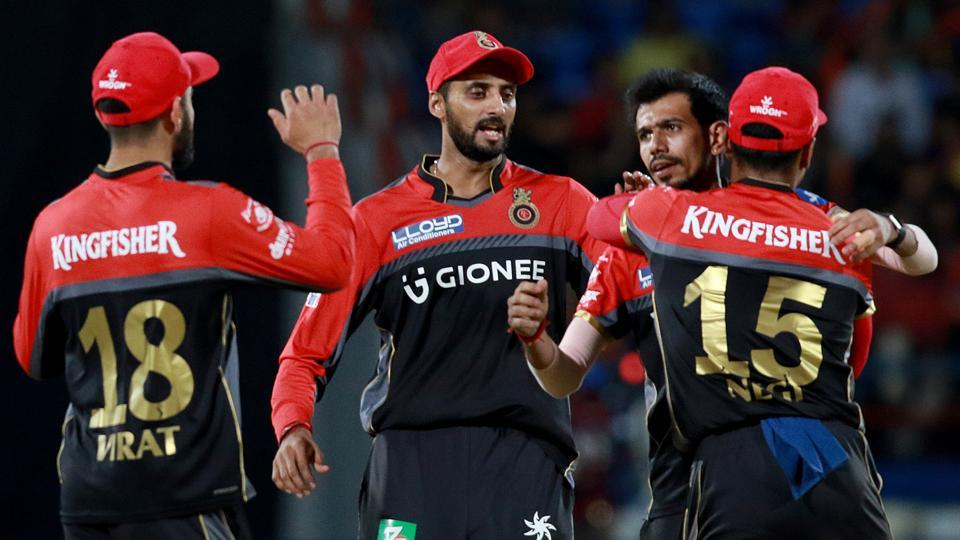 Yuzvendra Chahal of Royal Challengers Bangalore celebrates the wicket of Gujarat Lions' Brendon McCullum during their 2017 Indian Premier League at the Saurashtra Cricket Association Stadium in Rajkot on Tuesday. Catch full scorecard of Gujarat Lions vs Royal Challengers Bangalore here.
