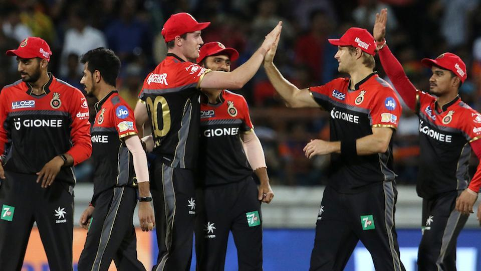 Royal Challengers Bangalore players celebrate the wicket of Brendon McCullum of Gujarat Lions during their 2017 Indian Premier League clash at the Saurashtra Cricket Association Stadium in Rajkot. Get IPL 2017 highlights of Gujarat Lions vs Royal Challengers Bangalore here.