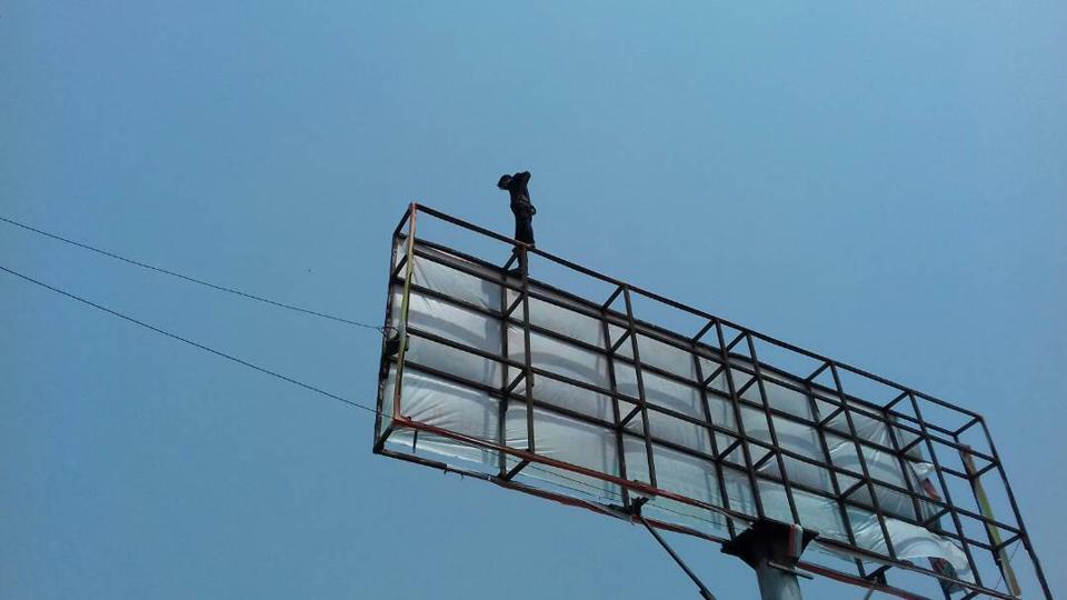 The 21-year-old man climbed the unipole installed on the Delhi-Saharanpur Road in Loni, Ghaziabad.