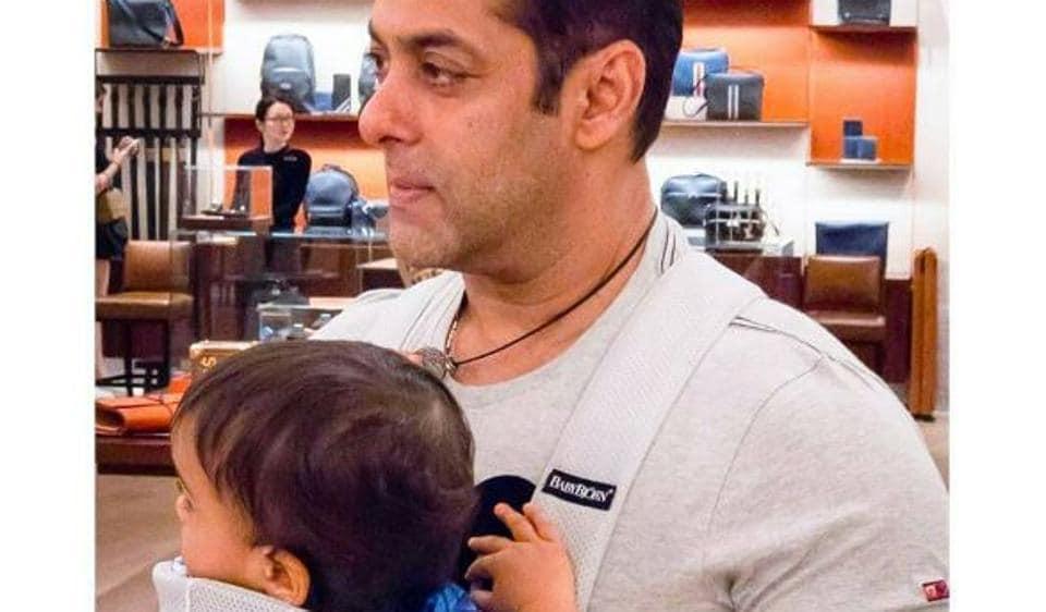 Salman Khan walks around a store with Ahil.