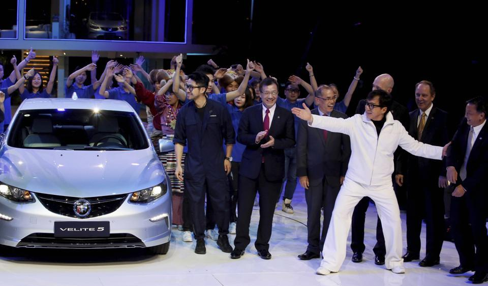 Movie star Jackie Chan, in white, attends the global launch of the Buick Velite 5, an extended range electric hybrid ahead of the Shanghai Auto 2017 show in Shanghai, China, on Tuesday.