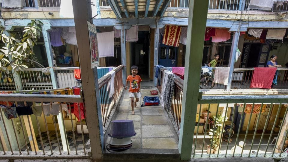 A child runs across 14D chawl at Thakurdwar, Kalbadevi in Mumbai. Chawls go back to British rule when traders set up textile mills in Mumbai and hired workers.
