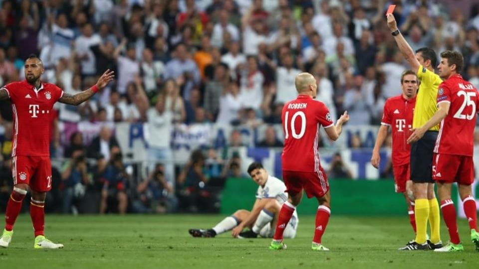 FC Bayern Munich's Arturo Vidal is shown a red card by referee Viktor Kassai during the UEFAChampions League match against Real Madrid C.F. on Tuesday.
