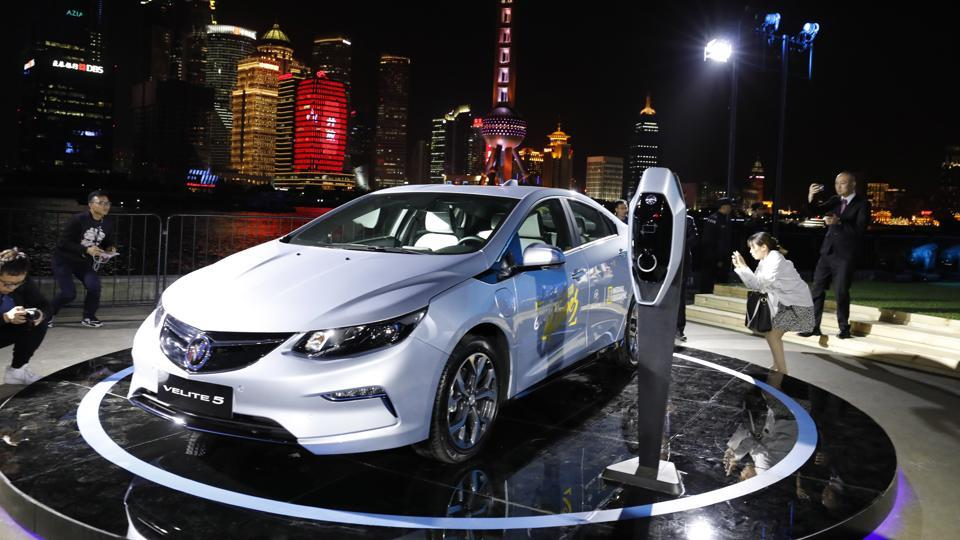 Visitors take photos of the Buick Velite 5, an extended range electric hybrid, during a global launch event ahead of the Shanghai Auto 2017 show in Shanghai on Tuesday. Buick, a subsidiary of the General Motors, got actor Jackie Chan to unveil the Buick Velite 5 at the Shanghai Auto Show. GM will make the Velite with its Chinese partner SAIC and has priced it at $38,600. (AP)