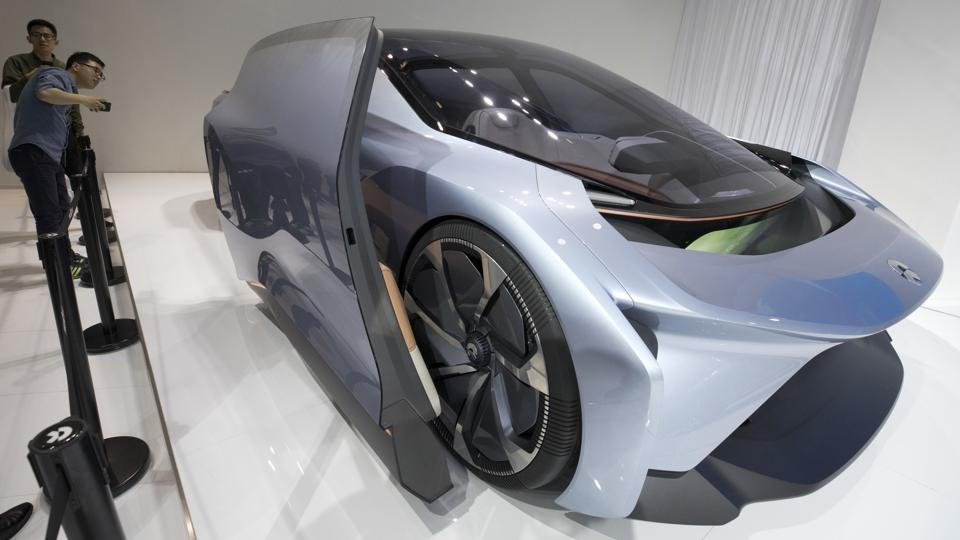 Visitors look at the Eve concept car from Chinese startup Nio at the Auto Shanghai 2017 show.  The Eve concept has been developed by Chinese startup Nio, formerly known as NextEV, which is backed by Chinese technology giants Tencent Holdings and Baidu Inc as well as Silicon Valley investors.  (AP)