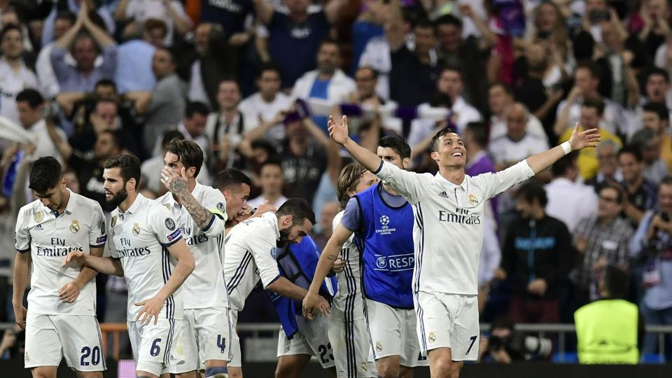Real Madrid C.F.'s Portuguese forward Cristiano Ronaldo celebrates with teammates after completing his hat-trick in their UEFA Champions League quarterfinal second leg match Real Madrid against FC Bayern Munich at the Santiago Bernabeu on Tuesday.
