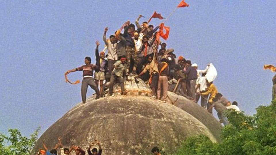 In this photograph taken on December 6, 1992, a Hindu mob attacks the 16th century Babri Masjid in Ayodhya. The Supreme Court on Wednesday revived criminal conspiracy charges against BJP leaders LK Advani, Murli Manohar Joshi, Uma Bharti and nine others.