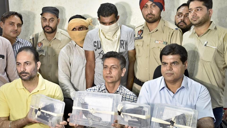 Police officials showing the recovered weapons during the press conference in Amritsar on Wednesday.