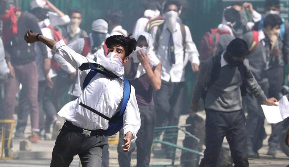 Kashmiri students clash with forces in Srinagar,  April 17. Stone-throwing protesters, some of them children, target police, soldiers and public property in repeated protests in the Kashmir Valley. Security forces, officially ordered to act with restraint and forbidden to use live ammunition except as a last resort, have still caused large numbers of deaths and injuries.