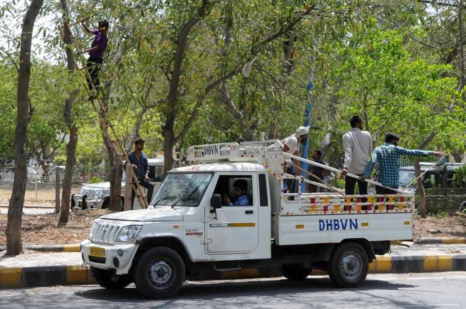 Workers of DHBVN started pruning the trees at Sushant Lok  on Wednesday.