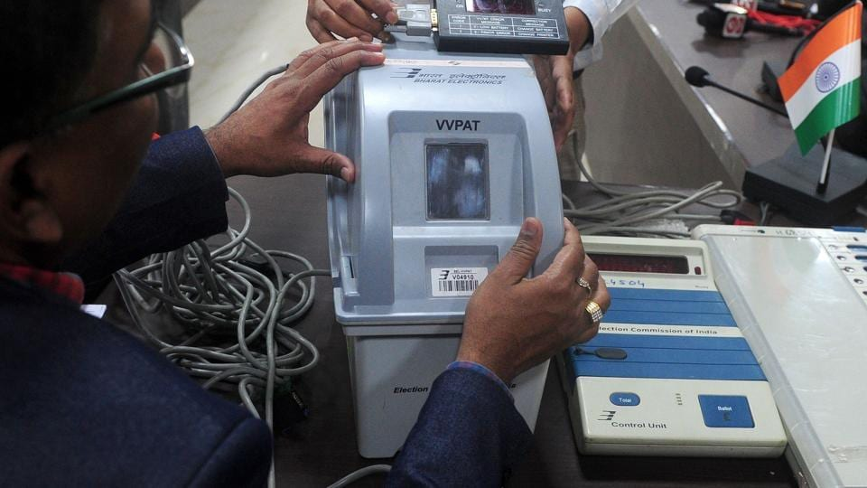 A district administrative officer explains a Voters Verifiable Paper Audit Trail (VVPAT) machine during a press conference in Allahabad on February 6, 2017.