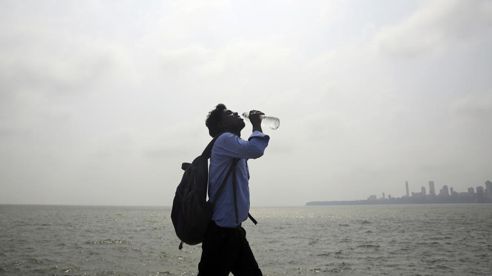 Representative Image: A man takes a drink as he walks by the Arabian sea in Mumbai. Hyderabad and several other parts of the state are reeling under heat wave, with mercury soaring above 40 degrees Celsius in some places.