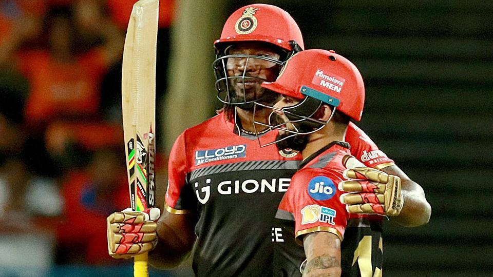 Royal Challengers Banglore captain Virat Kohli and batsman Chris Gayle during the IPL T 20 match against Gujarat Lions in Rajkot on Tuesday.