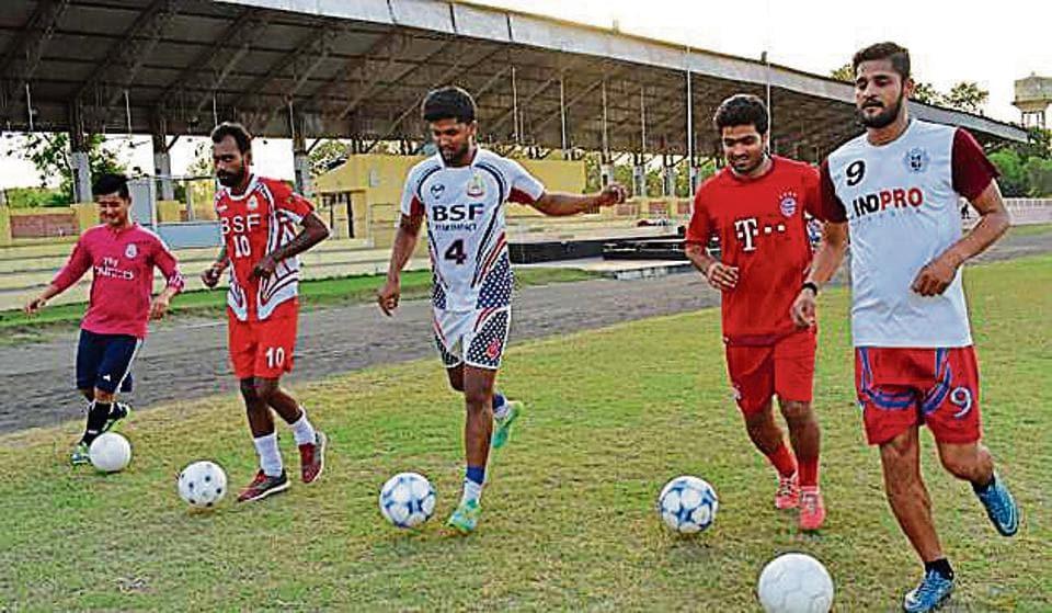 Players practising football at Ashwani Stadium in Jalandhar on Wednesday.
