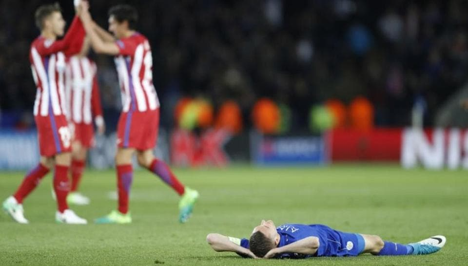 Leicester City F.C.'s Jamie Vardy lies down on the ground dejected after the UEFA Champions League quarterfinal match against Atletico Madrid  on Tuesday.