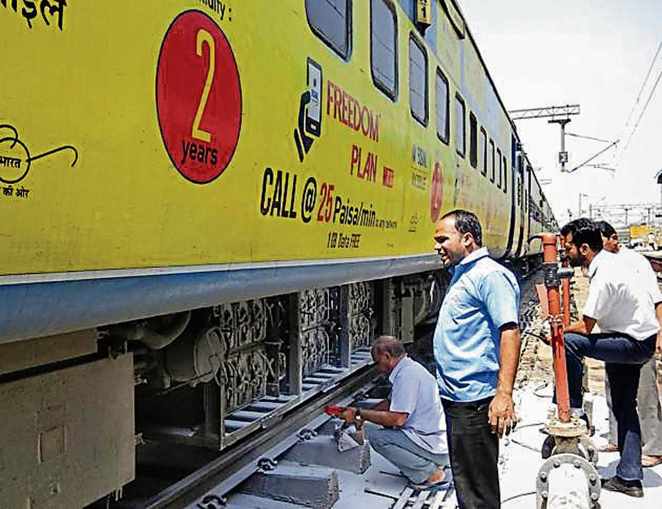 Mechanics working on an air-conditioned coach of the Dadar Express after a battery caught fire at the Ludhiana railway station on Wednesday.