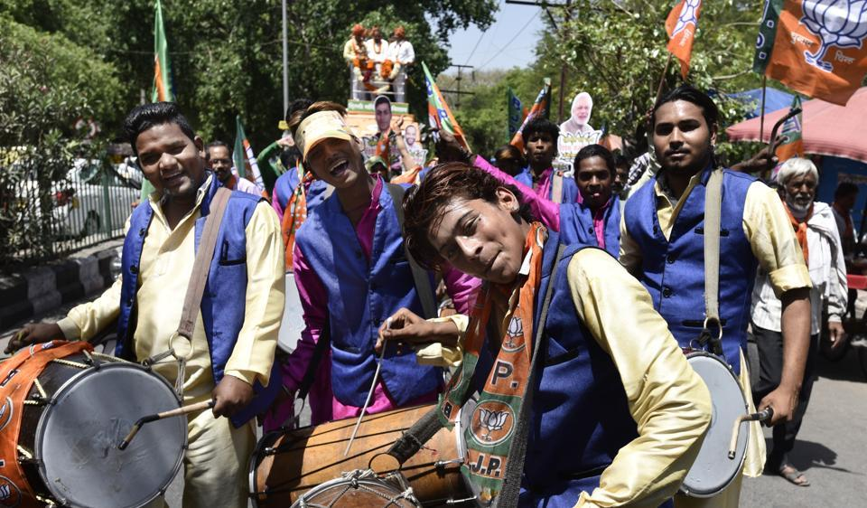 Supporters of Bharatiya Janata Party (BJP) during the MCD election campaign in Pushp Vihar