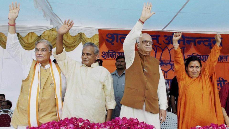 In this file photo, BJP leaders LK Advani, Murli Manohar Joshi, Kalyan Singh and Uma Bharti wave at the crowd at a public meeting after appearing in a special court in connection with the demolition of Ayodhya's Babri Masjid, in Rae Bareli, July 28, 2005. The Supreme Court on Wednesday restored criminal conspiracy charges against Advani, Joshi and Bharti and others in the case.