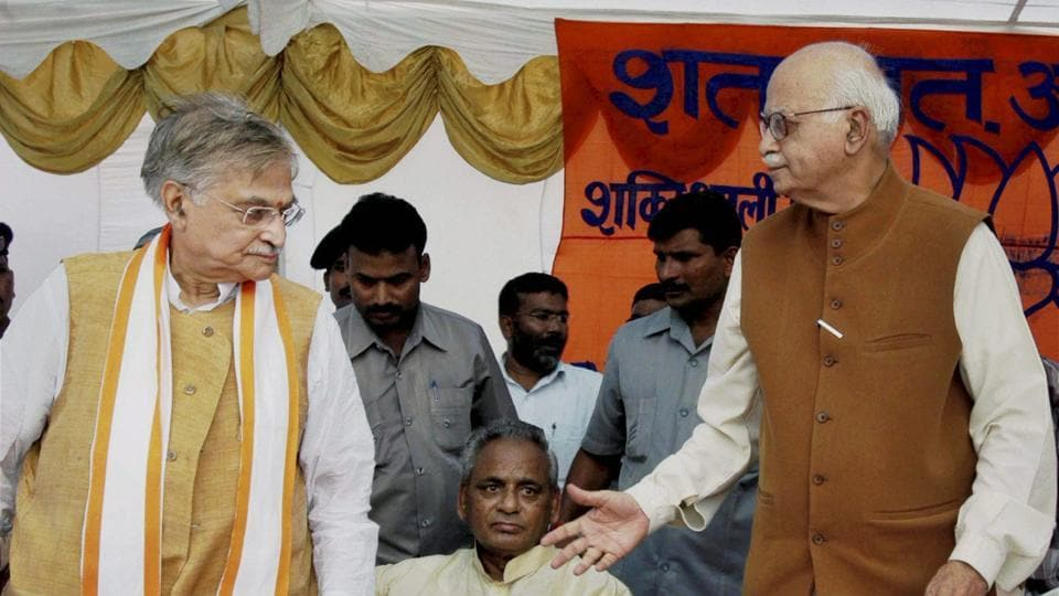 In this file photo, BJP leaders LK Advani and Murli Manohar Joshi attend a public meeting after appearing in a special court in connection with the demolition of Ayodhya's Babri Masjid, in Raebareli, July 28, 2005. The Supreme Court on Wednesday restored criminal conspiracy charges against Advani, Joshi and Bharti and some others in the case.