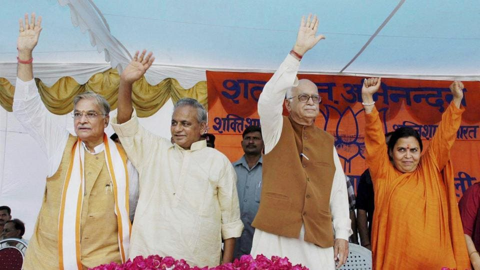 In this file photo, BJP leaders LK Advani, Murli Manohar Joshi, Kalyan Singh and Uma Bharti wave at the crowd at a public meeting after appearing in a special court in connection with the demolition of Ayodhya's Babri Masjid, in Raebareli, July 28, 2005.