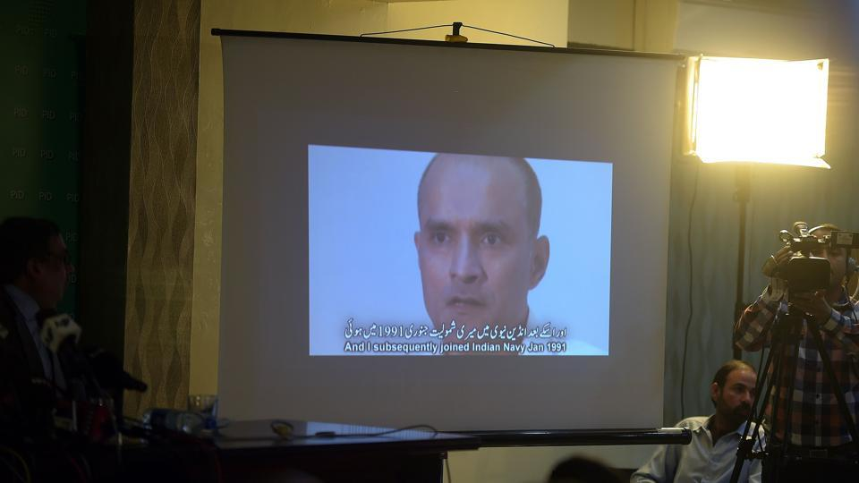 Pakistani journalists watch a video showing Indian national Kulbhushan Yadav, arrested on suspicion of spying, during a press conference in Islamabad.  The photograph taken on March 29, 2016.