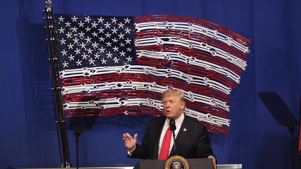 President Donald Trump speaks to workers at the headquarters of tool manufacturer Snap-On on April 18, 2017 in Kenosha, Wisconsin. During the visit, Trump signed an executive order to try to bring jobs back to American workers and revamp the H-1B visa guest worker program.